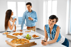 Home Party. Friends Having Dinner Indoors, Eating Fast Food. Cel Royalty Free Stock Photos