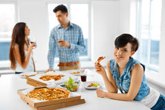 Home Party. Friends Having Dinner Indoors, Eating Fast Food. Cel Stock Photos