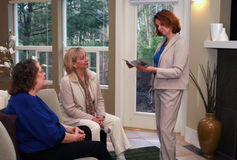 Home Party Presentation. Three women gather for an in home party presentation Stock Photos