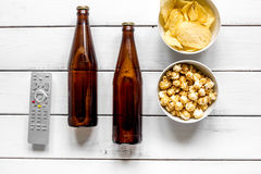 Home party with TV watching, snacks and beer on white background top view. Home party with TV watching, snacks, pop corn, chips and beer on white background top Stock Photos
