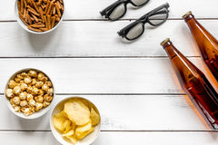 Home party with TV watching, snacks and beer on white background top view. Home party with TV watching, snacks, pop corn, chips and bread crumbs and beer on Stock Image