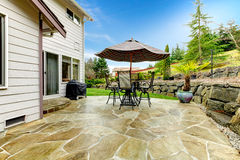 Home patio area overlooking beautiful landscaping Royalty Free Stock Image