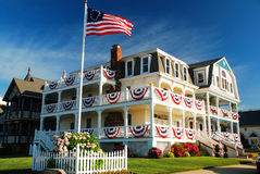 A Home Patriotically Decorated in Ocean Grove on the New Jersey Shore. Ocean grove, along the Jersey Shore, breaks out their red, white and blue on the Fouth of royalty free stock photography