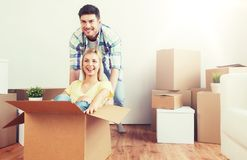 Happy couple having fun with boxes at new home Stock Photo