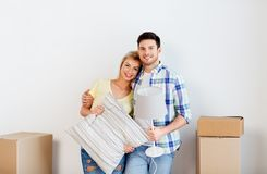 Couple with pillow and lamp moving to new home stock photos