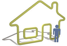 Home person stands by 3D symbol house outline Royalty Free Stock Photos