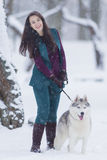 Home Pets Concept and Ideas. Happy Caucasian Brunette Woman and Her Husky Dog. Royalty Free Stock Photography