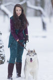 Home Pets Concept and Ideas. Happy Caucasian Brunette Woman and Her Husky Dog Stock Photos