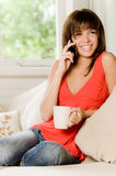 At Home On Phone Royalty Free Stock Photos