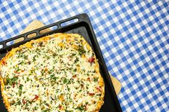 Home pizza on a baking sheet royalty free stock photography