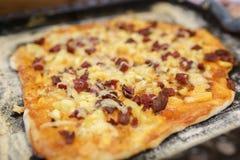 Home pizza on a baking sheet Stock Photos