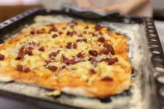 Home pizza on a baking sheet Royalty Free Stock Images