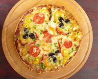 Home pizza with tomato and eggplant Royalty Free Stock Photos