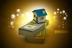 Home placed on the tope of dollar notes. In color background Royalty Free Stock Photos