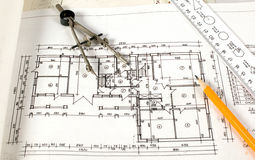 Home plan with drawing tools. It is a plan of home with drawing tools on it Stock Photography