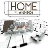 Home planning sign with project of house. On blueprints Royalty Free Stock Images