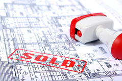 Home plans with stamp SOLD. Architectural plans and stamp SOLD Stock Photos