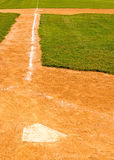 Home plate polygon and chalk base path to third base Stock Photos