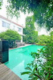 Home with a pool. In home Royalty Free Stock Photography
