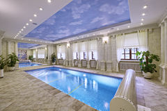 Home pool. Great pool in luxurious house Royalty Free Stock Photography
