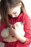 Child and kitten Stock Image