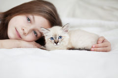 Child and kitten Royalty Free Stock Photos