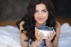 Home portrait of a happy woman with ripe berries Royalty Free Stock Photography