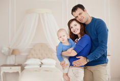 Home portrait of happy young family. Stock Photography