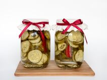 Home Preserved Dill Pickles With Red Hot Peppers Royalty Free Stock Photo