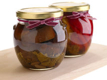 Home preserves. On wooden background Stock Photography