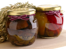 Home preserves. On wooden background Royalty Free Stock Images