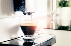 Home professional coffee machine with espresso cup. Coffee machine espresso kitchen cup hot italian white concept Royalty Free Stock Images