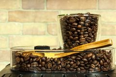 Home professional coffee machine with espresso cup. Coffee preparation. Espresso coffee maker machine and coffee beans.  stock images