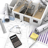 Home purchase process. A house on top of a table with mortgage application form, calculator, blueprints, etc royalty free stock photo