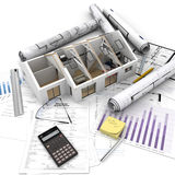 Home purchase process. A house on top of a table with mortgage application form, calculator, blueprints, etc stock photo