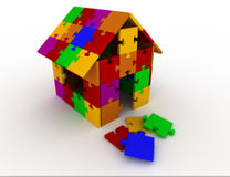 Home  puzzle. A house built in puzzle Royalty Free Stock Images