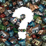 Home Question. S and a real estate business symbol of uncertainty of the housing construction industry with a group of houses shaped as a question mark as a 3D Royalty Free Stock Images