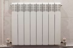 Home radiator heater on white wall stock photo