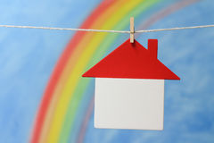 Model of a house with a rainbow and blue sky. Royalty Free Stock Images
