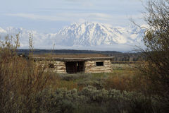 Home on the Range. Cunningham Cabin sits  on the range with the snow covered Grand Teton mountains loomingin the distance Stock Photography