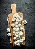 Home raw dumpling on wood cutting Board. On black rustic background stock images
