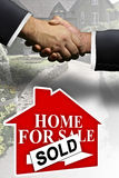 Home real estate sale 2. Two business men shaking hands over money transaction deal Royalty Free Stock Photos
