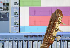 Home recording studio. With closeup of guitar and music software. Focus on guitar headstock Royalty Free Stock Photo