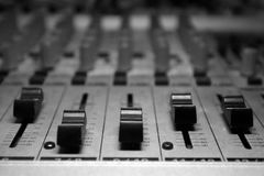 Home recording studio/mixer. Small depth of field focused on scale/controller stock photos