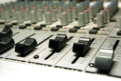 Home recording studio/mixer. Small depth of field focused on scale/controller stock images