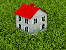 Home with red roof on grass Royalty Free Stock Photography
