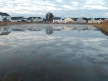 Home Reflections off a pond. This is a photo of homes reflecting off a pond Royalty Free Stock Photography