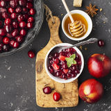 Home Relish sauce of apples and cranberries for submission to various dishes the family dinner. The concept the. Home Relish sauce of apples and cranberries for royalty free stock images