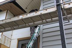 Home remodeling with new siding stock images