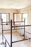 Home renovation. Scene with scaffolding and ladder in modernized room Stock Image
